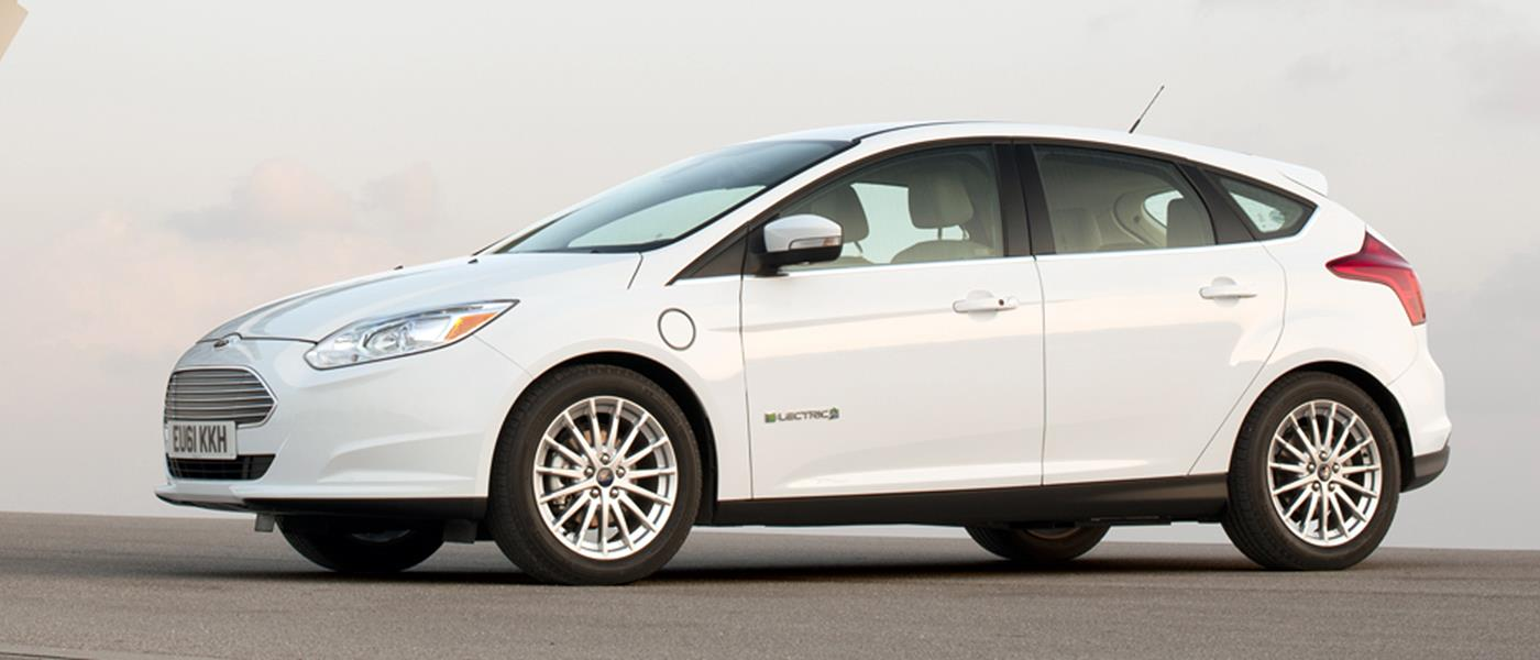 The charge panel above the front wheel is the only visible clue that the ford focus